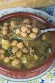 pic of bengal-gram  - Stew of chickpeas and spinach with cod on a table with a tablecloth - JPG