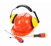 Hard hat ear muffs and screwdrivers.