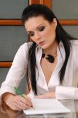 Attractive Businesswoman Writing A Message