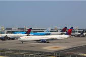 KLM Boeing 747 and Delta Airline planes at the gates at the Terminal 4 at JFK Airport