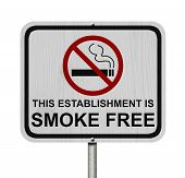 stock photo of traffic rules  - Smoking Free Establishment Sign An red road sign with cigarette icon and not symbol with text isolated on white - JPG
