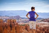 Tourist Admiring Nature In Bryce Canyon National Park