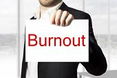 Businessman Holding Sign Burnout