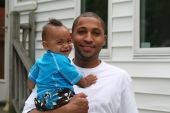 African American Man and Toddler in Backyard