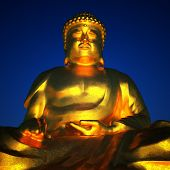 Golden Buddha on blue sky