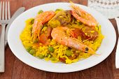 Paella On White Plate And Glass Of Water