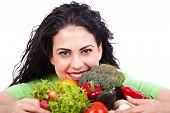 Young woman holding vegetables