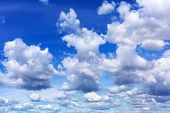 Clouds over blue sky background