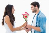 Happy hipster giving his girlfriend roses on white background