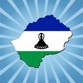 Lesotho map flag on blue sunburst illustration