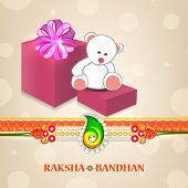 Big gift boxes and teddy bears with pearls decorated rakhi on shiny brown background for Raksha Band