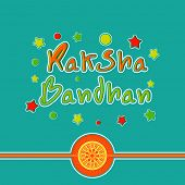 Beautiful rakhi on colorful stars decorated green background for the Raksha Bandhan festival celebra