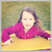 Sweet little girl at playground - With Instagram effect