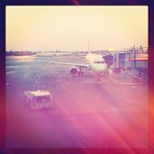 A View of airplane from airport window - instagram effect