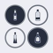 picture of vodka  - 4 alcohol bottles icons shows off different bottles shapes like a vodka and a beer. Pictured here from left to right - 