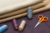 Thread Spools, Pin And Scissors.