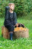 Boy and basket full of chanterelles