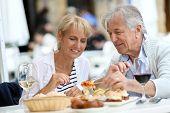 Senior couple eating Spanish fingerfood in Spain