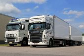 White Scania R560 And Volvo FH Full Trailer Trucks