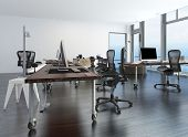 Contemporary minimalist office interior with workstations set up on a movable table and a floor-to-c
