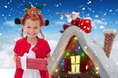 stock photo of rudolph  - Cute little girl wearing rudolph headband against bright blue sky over clouds - JPG