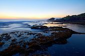 pic of tanah  - Tanah Lot Temple and ocean waves at sunset Bali Indonesia - JPG