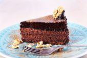 Delicious chocolate cake on plate on bright background