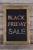Vintage sign board with Black Friday Sale text on it on wooden background
