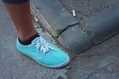 Woman Wearing Blue Shoes At The Park.
