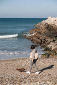 Women Walking  With Dachshund Dog