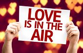 Love Is In The Air card with heart bokeh background