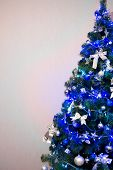 stock photo of cozy hearth  - Christmas tree background. Blue toned close up ** Note: Visible grain at 100%, best at smaller sizes - JPG