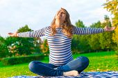 pic of breathing exercise  - pregnant girl is preparing for the birth. doing breathing exercises on the nature