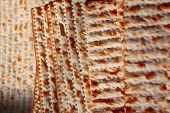 stock photo of circumcision  - pieces of matza Jewish bread fried in the fire picture sdelanaya close - JPG