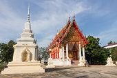 white pagoda and Temple at Wat Ban Ma