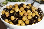 Marinated olives in bowl, close-up