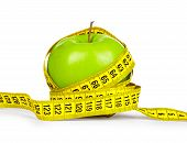 Diet Concept. Green Apple And Yellow Measuring Tape On An Isolated White Background.