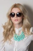 blonde with long hair in necklace. sunglasses