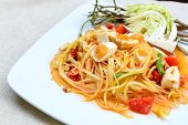 pic of green papaya salad  - Close up of green papaya salad with salted egg Thai food - JPG