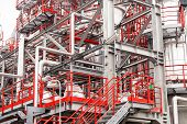 picture of pipeline  - detail of oil pipeline with valves in large oil refinery - JPG