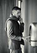 Handsome Stylish Young Man Using A Pay Phone