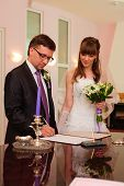 Young wedding couple on signing ceremony