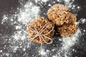stock photo of baked raisin cookies  - oatmeal cookies with raisins and flour on wooden table - JPG