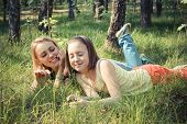 Girl with her mom relax in park