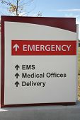 picture of emergency treatment  - Red and white emergency room sign outdoors at hospital - JPG
