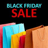 Paper shopping bags and Black Friday Sale text