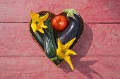 Fresh Vegetables In Wooden Heart Form Basket On Table