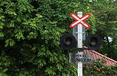 Stop sign at a cross with railway train.