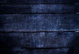 image of lumber  - Old dark blue grunge wood background with knots and scratches - JPG