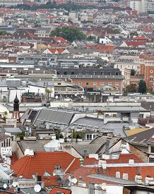stock photo of overpopulation  - Aerial view of the city with many homes and houses of citizens in europe - JPG